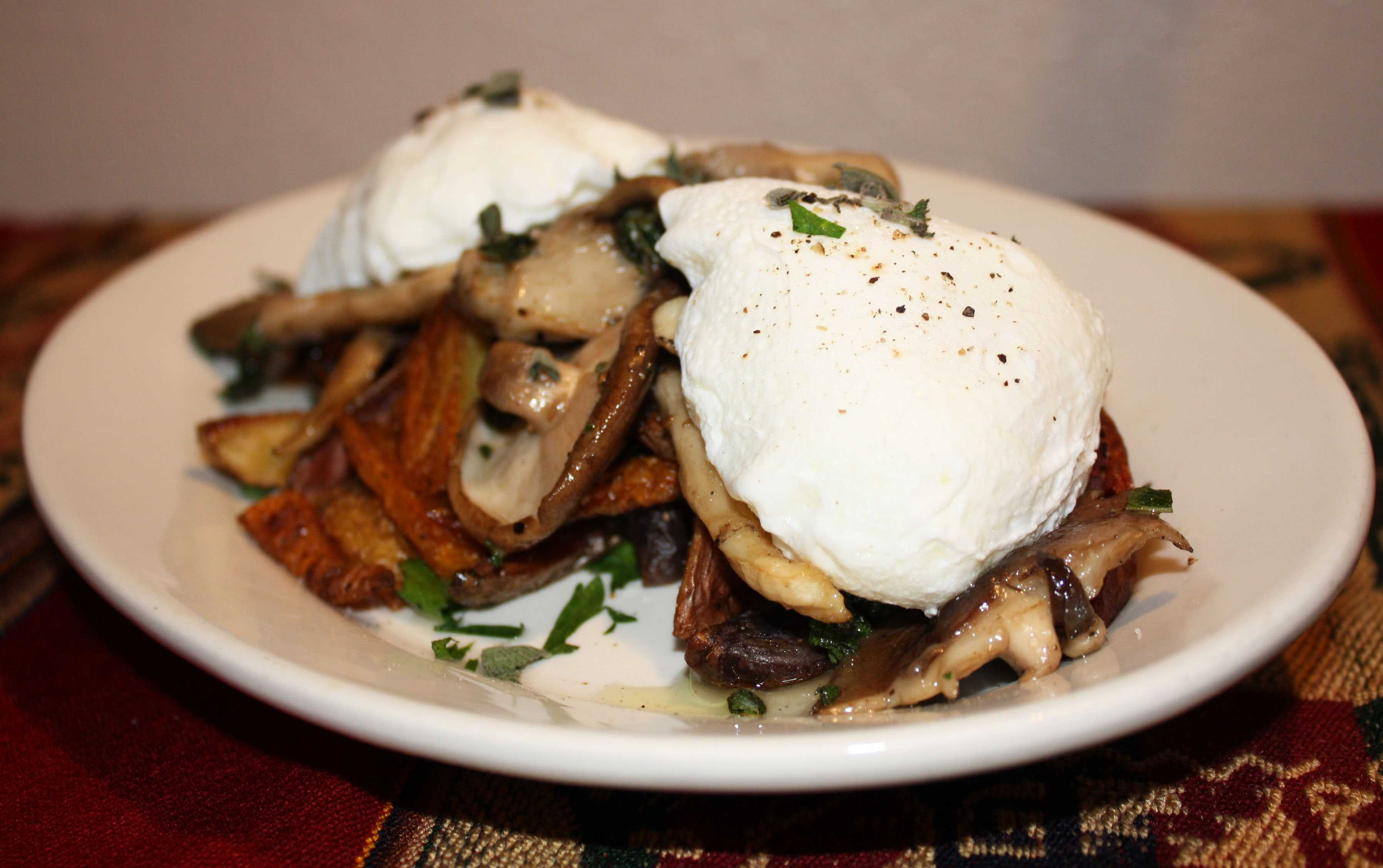 The smoky flavor of shiitake mushrooms and velvety oyster mushrooms make for a delicious and unique breakfast when paired with poached eggs. Photo Credit: Lauren J. Mapp/The Mesa Press