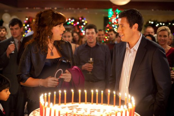 Adam Sandler - seen her next to a surprise birthday party cake - plays twins Jack and Jill Sadelstein in the newest Sandler film
