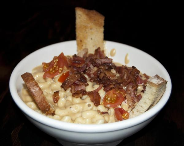 Guinness-infused beer mac n' cheese combines a classic childhood comfort food and candied bacon with the quintessential stout ale. Photo Credit: Lauren J. Mapp