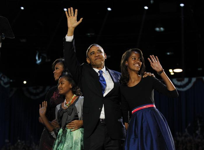 President Barack Obama greets the crowd at his election-night headquarters with his wife, Michelle, left, and daughters Sasha and Malia, right, as they celebrate his re-election on Wednesday, November 7, 2012, in Chicago, Illinois. (Brian Cassella/Chicago Tribune/MCT)