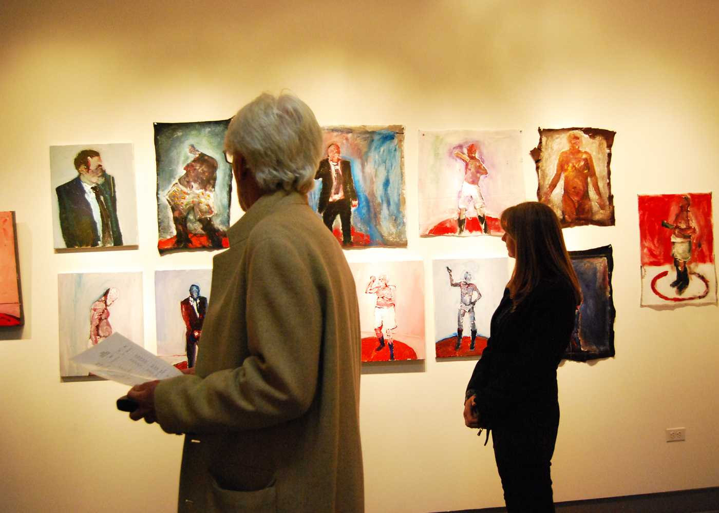 Local art patrons browse the featured works of the Dynamic Gestures exhibit at the Mesa Art Gallery.