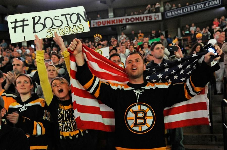 Boston Bruins fans Yvonne and Jake Patterson cheer at the start of an NHL game between the Bruins and the Buffalo Sabers at TD Garden in Boston, Massachusetts, Wednesday, April 17, 2013. (Christopher Evans/Boston Herald/MCT)
