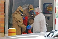 A patient transported from Frisco, Texas, with concerns of possible exposure to Ebola, arrives at the emergency room entrance of Texas Health Presbyterian Hospital in Dallas on Wednesday, Oct. 8, 2014. (Louis DeLuca/Dallas Morning News/MCT)