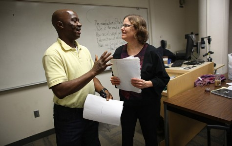 Student James David, left, laughs with professor Anne Winkler-Morey as they talk about an assignment on March 5, 2014. Winkler-Morey teaches as an adjunct professor at Metro State University in Minneapolis. (Kyndell Harkness/Minneapolis Star Tribune/MCT)