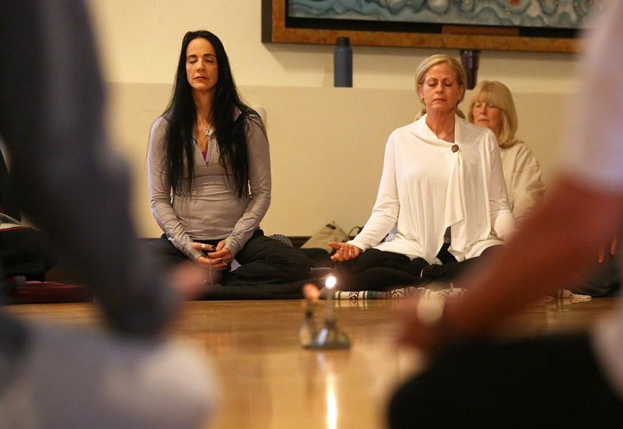 Yolanda Landow and Weezy Gardner meditate during a Midwest Moon Sangha gathering at the Wehrli Chapel on the Webster Groves campus in St. Louis on Saturday, Oct. 3, 2015. The meditation session was followed by a quiet walking portion and concluded with second portion of sitting. (Roberto Rodriguez/St. Louis Post-Dispatch/TNS)