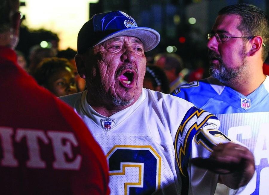 San+Diego+Chargers+fan+Jesse+Constancio%2C+a+season+ticket+holder+for+22+years%2C+speaks+to+television+cameras+as+he+and+other+fans+enter+Spreckles+Theater+for+a+town+hall+meeting+with+NFL+representatives+to+discuss+the+future+of+the+Chargers+in+San+Diego+on+Wednesday%2C+Oct.+28%2C+2015.+