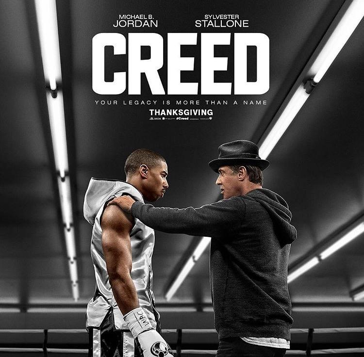 Adonis+Creed+%28Michael+B.+Jordan%29+and+Rocky+Balboa+%28Sylvester+Stallone%29+stand+in+the+boxing+ring+in+preparation+for+Creed%27s+big+fight.
