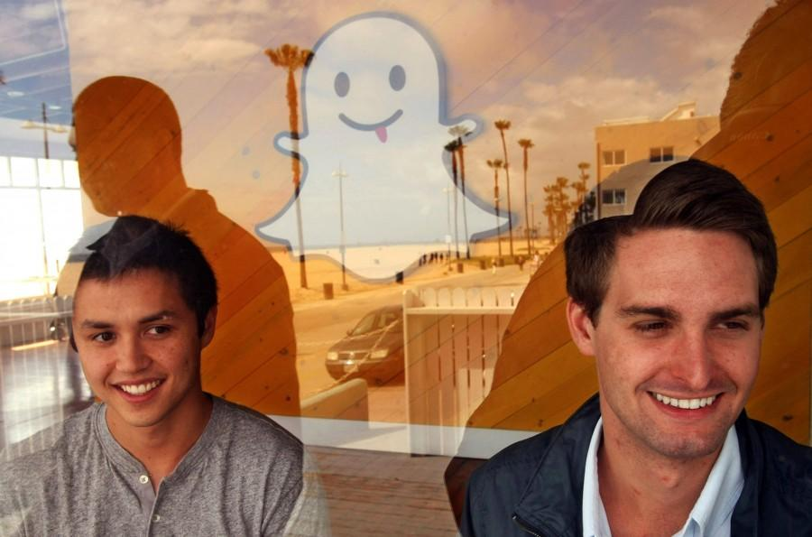 Bobby Murphy, 24, left, and Evan Spiegel, 22, co-creators of Snapchat, are seen through a window of the company's offices on Ocean Front Walk on May 6, 2013 in Venice, Calif. In 2013, co-founder Reggie Brown sued his former colleages and venture capitalists, alleging breach of contract. (Genaro Molina/Los Angeles Times/TNS)