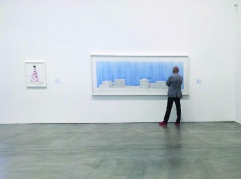 An visitor examines the detail of Do Ho Suh's architectural style.