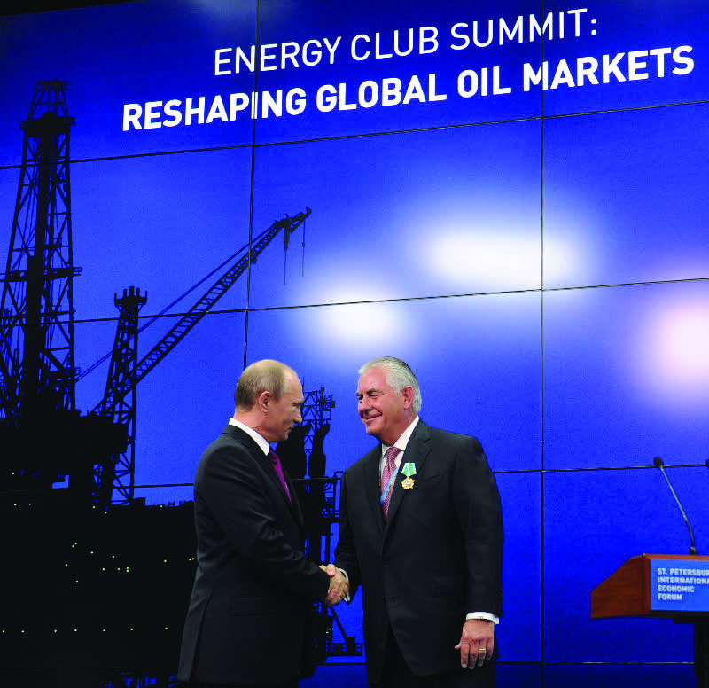 U.S. President-elect Donald Trump announced in December 2016 that he has picked Exxon Mobil CEO Rex Tillerson, right, to be secretary of state, here in a June 2013, file image with Russian president Vladimir Putin in St. Petersburg, Russia. (Mikhail Klimentyev/ITAR-TASS/Zuma Press/TNS)