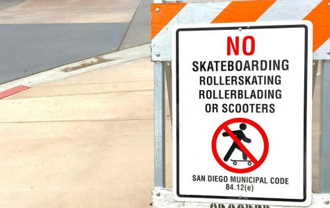 Signs prohibiting skateboarding are posted at campus entrances.