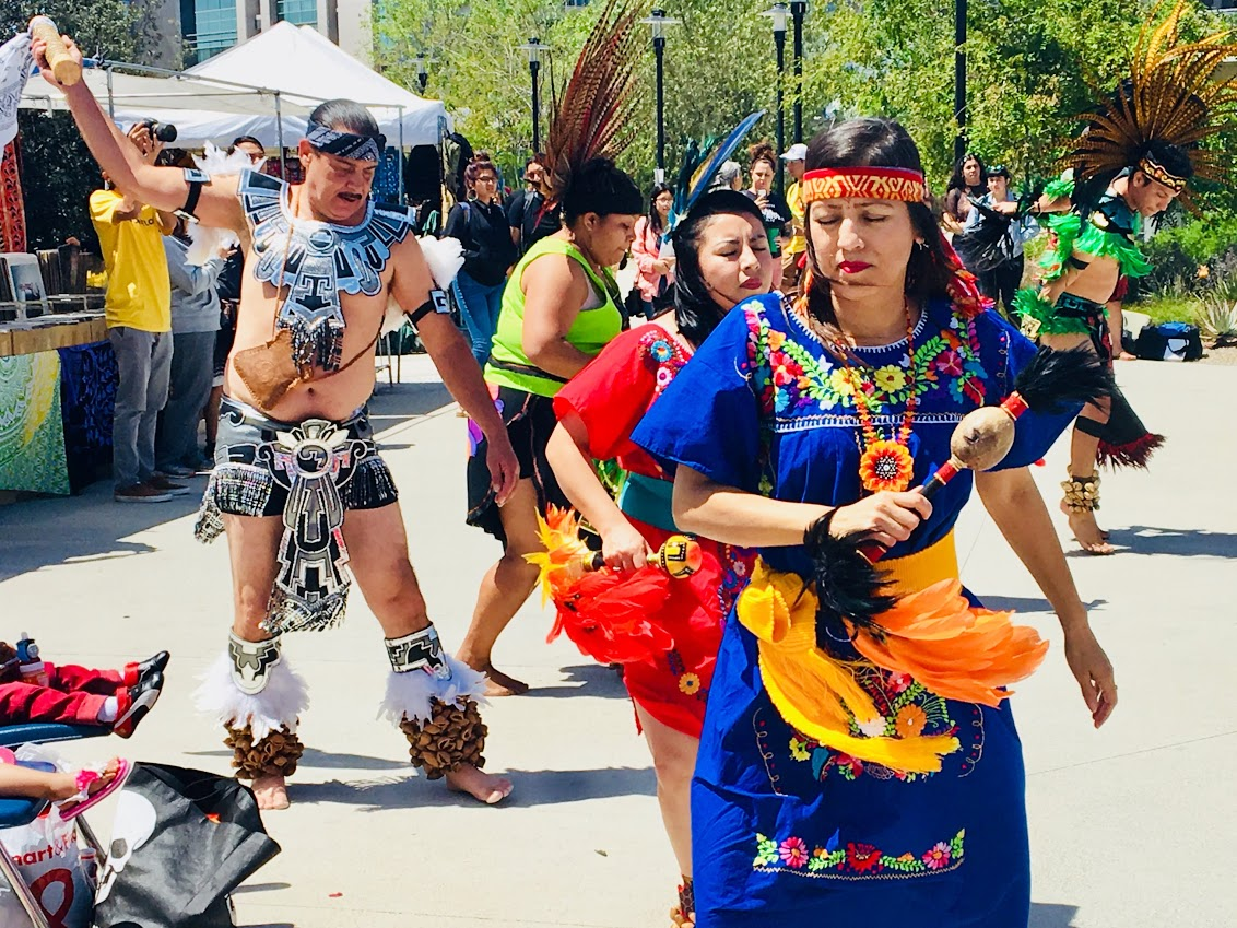 Dancers perform what is known as Danza Azteca at Mesa's Sunrise Plaza.
