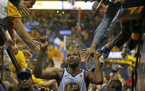 Kevin Durant exits to the Warriors locker room after a first round victory against the San Antonio Spurs