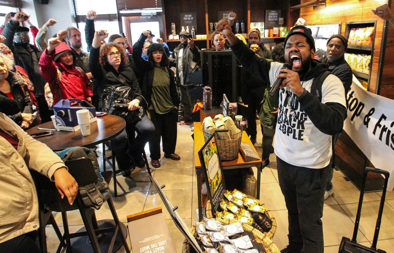Anthony Smith, right, speaks out during the protest at Starbucks in Philadelphia.