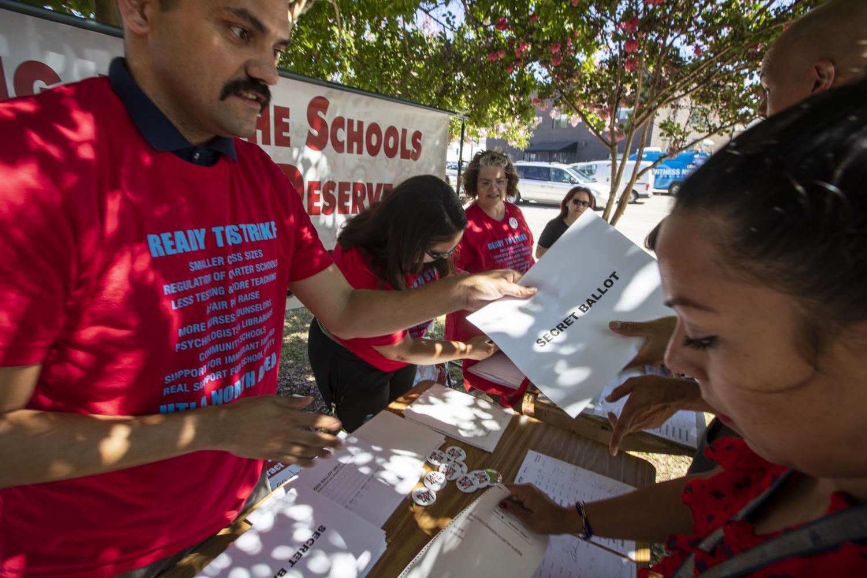 Petitioner Asking For Signatures. Photo Credit: MCT Campus.