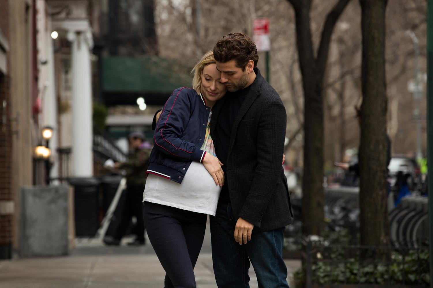 Happy couple Will (Oscar Isaac) and Abby (Olivia Wilde) share a sweet embrace in the streets of New York City.
