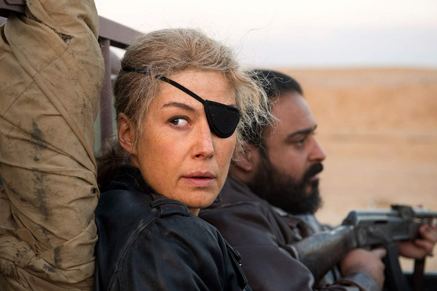 Marie Colvin (Pike) always needing to look over her shoulder in war zones.