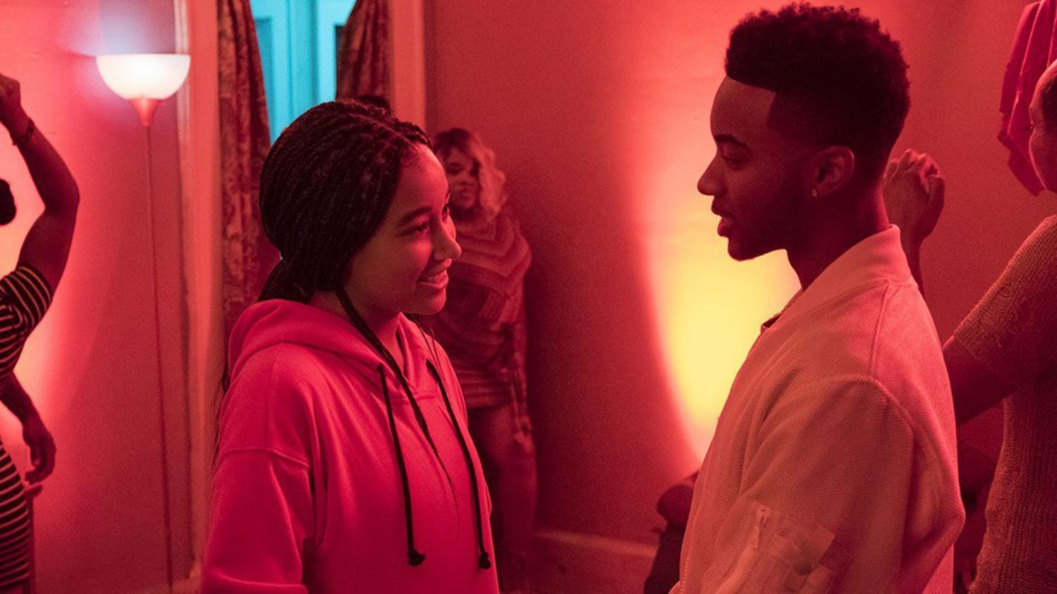 Starr (Amandla Stenberg) and Khalil (Algee Smith) reconnect at a party in their neighborhood.