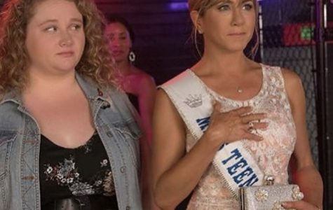 Former pageant queen Rosie (Aniston) in an emotional moment watching the current contestants while her daughter Willowdean (Macdonald) clearly doesn't share the feeling.