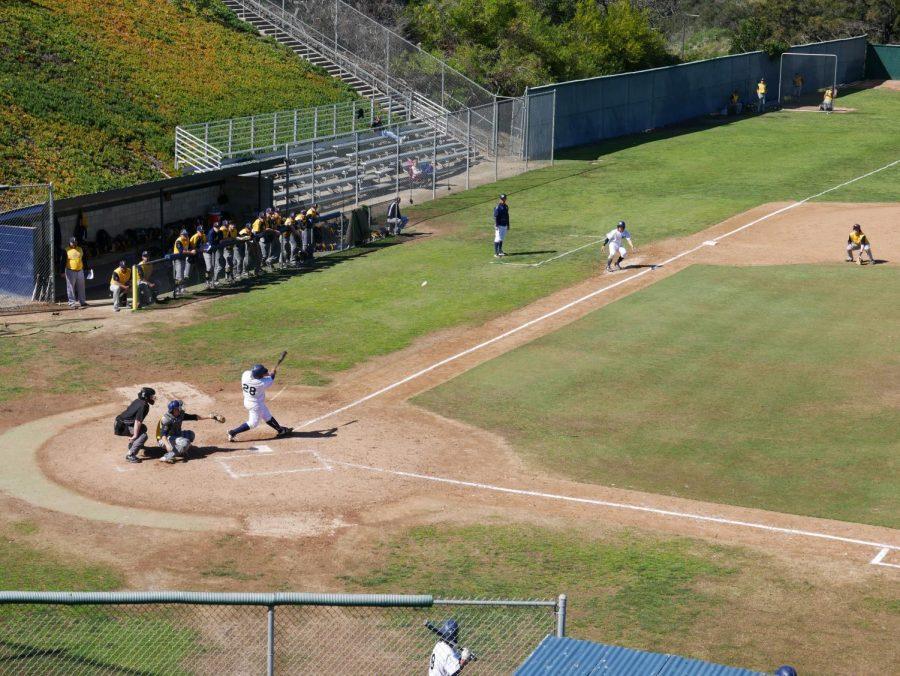 No. 28, Jorge Martinez, Sophomore, sends a rocket out to left field. Photo Credit - Erik Acosta.