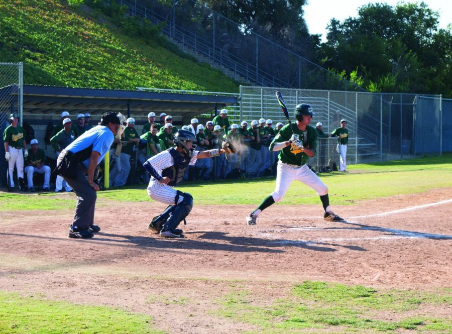 Photo+caption+-+No.+3%2C+Mesa+catcher%2C+Jacob+Engel%2C+Sophomore%2C+catches+a+high+fastball+as+No.+19%2C+Enrique+Bennett%2C+holds+the+swing.+Photo+Credit+-+Erik+Acosta.