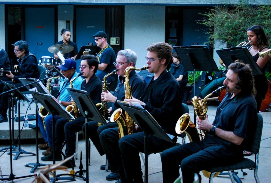 Mesa College's Jazz Big Band Ensemble in the middle of their evening performance.