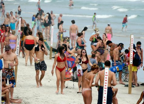 Spring breakers and tourists ignore social distancing warnings and go to the beach.