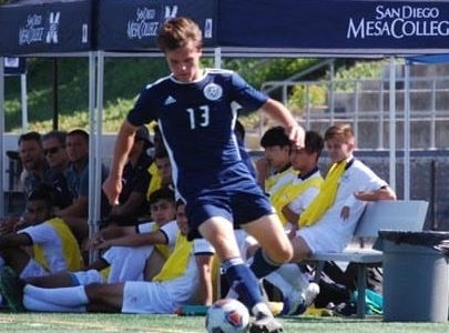 Guthrie controlling the soccer ball during a game.
