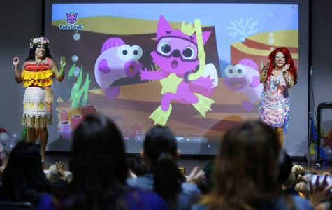 Barbie_Q, left, and Raquelita, sing the song Baby Shark during Drag Queen Story Time at the Chula Vista Civic Center Library.