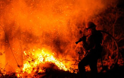 Firefighters perform structure protection against the Glass Fire in Napa County