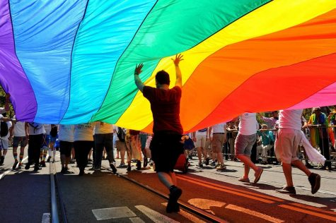 "National Coming Out Day is an annual LGBTQ+ awareness day to support those in the LGBTQ+ community to ""come out of the closet""."