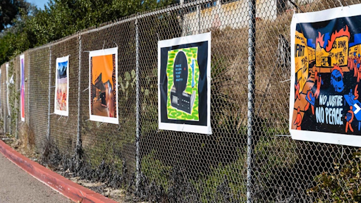 Art pieces line Mesa College's parking lot during this semester's outdoor art exhibition
