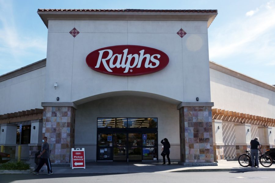 LONG BEACH, CA - FEBRUARY 02: People enter and exit a Ralphs store which Kroger, its parent company will shut down in response to the city imposing a