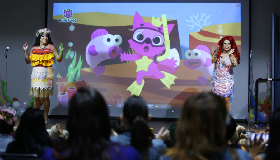 Barbie Q, left, and Raquelita, right, sing the song Baby Shark during Drag Queen Story Time at the Chula Vista Civic Center Library on Sept. 10, 2019.