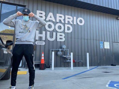 Willie Wingz posing in front of Barrio Food Hub via instagram @willie_wingz