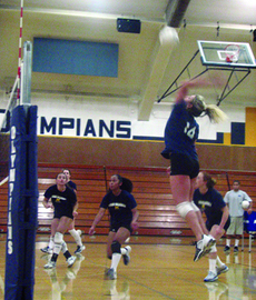 Hard Hitters: Lady Olympians' volleyball team spikes their way to the State Playoffs