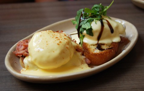 The mix and match eggs Benedict lets you diversify your breakfast meal at Snooze. Featured here is a traditional-style Ham Benedict III with smoked cheddar hollandaise sauce [left] and the Bella! Bella! Benny with prociutto, arugala and balsamic glaze [right]. Photo by Lauren J. Mapp