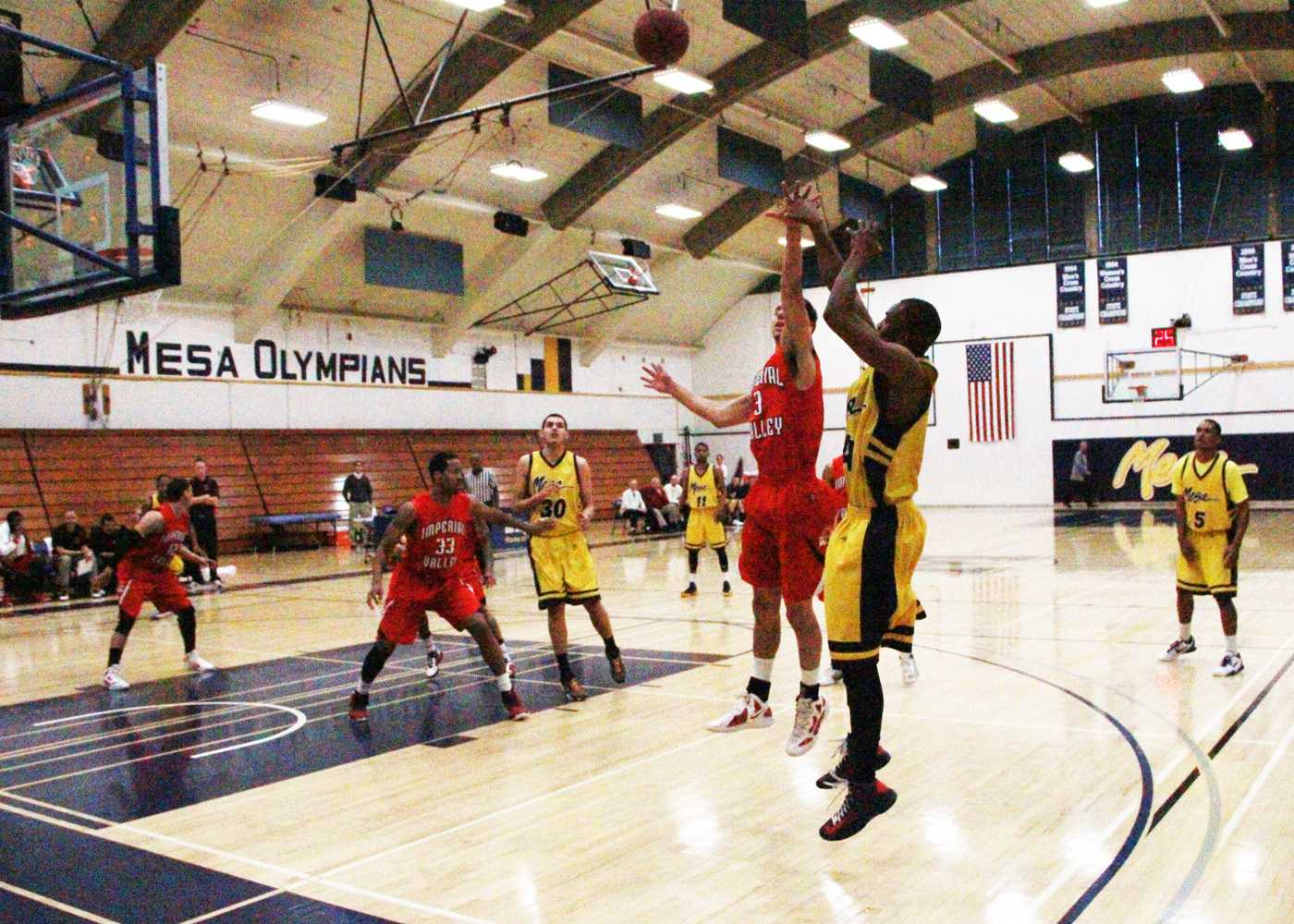 Otis Barrow shoots for three against Imperial Valley College in a 77-76 Win
