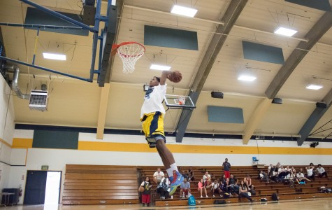 Slam dunk winner Darreon Tolliver shows off his high rising ability in the Midday Madness Slam Dunk competition on Oct. 1.