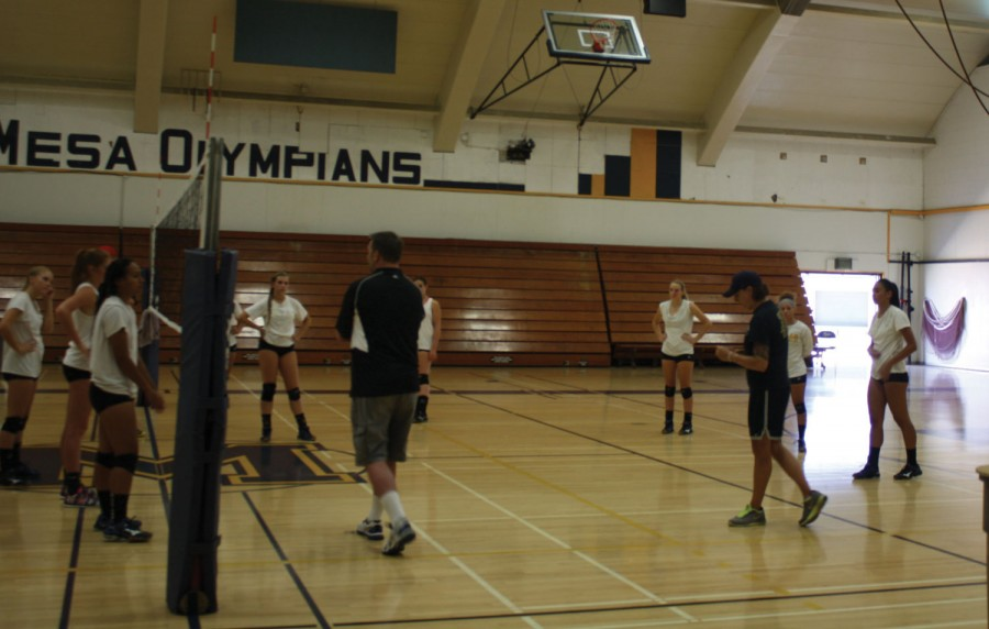 Mesa women's volleyball coach Kim Lester (right) gives her team instructions on court position during a recent practice.