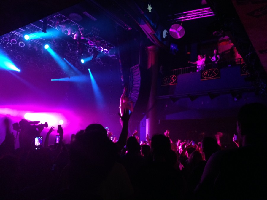 David Boyd, lead singer of New Politics, engages with the audience at the House of Blues.