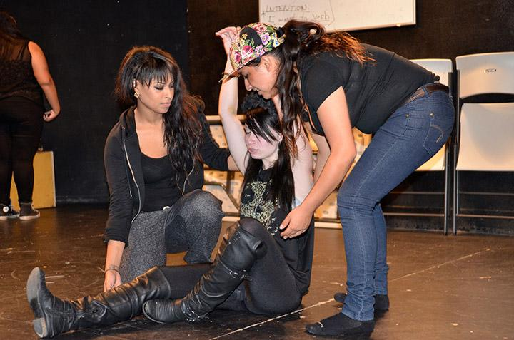 Genesis Canty, Christina George and Chris Cortez rehearsing a scene from the upcoming play