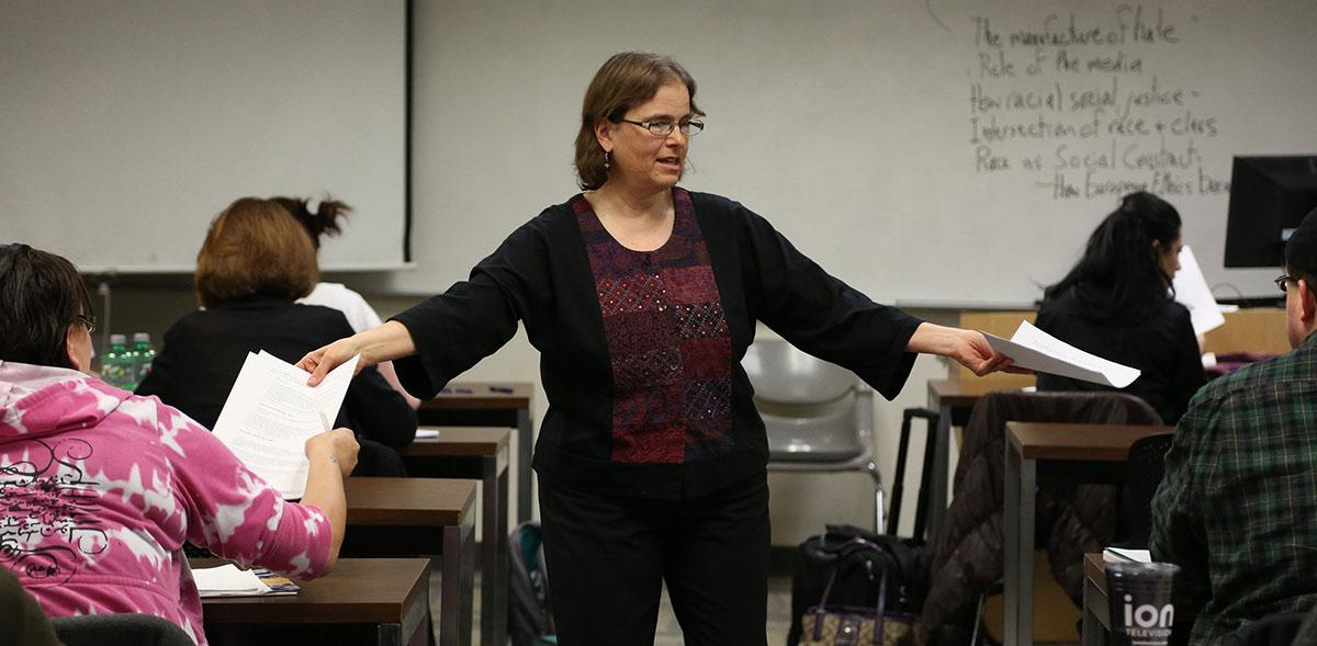 Professor Anne Winkler-Morey gives her students instructions as she hands out their midterm on March 5, 2014. Winkler-Morey teaches as an adjunct professor at Metro State University in Minneapolis. (Kyndell Harkness/Minneapolis Star Tribune/MCT)