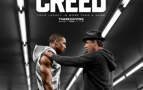 Adonis Creed (Michael B. Jordan) and Rocky Balboa (Sylvester Stallone) stand in the boxing ring in preparation for Creed's big fight.