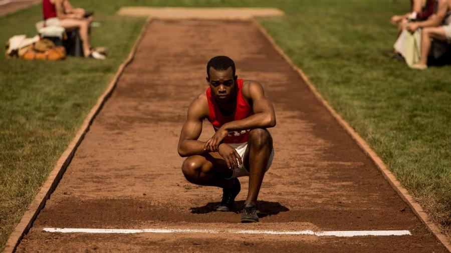 Jesse Owens, played by Stephan James, inspecting the field moments before proving to the world that race means nothing. Photo Credit: MCT Campus