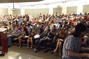 VAMP audience prepares  to hear students' personal testimonies.