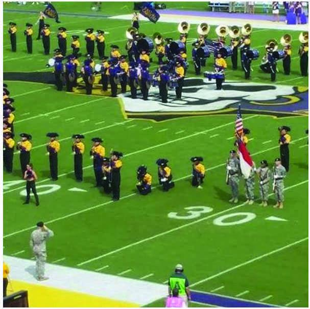 ECU Band members kneeling during the national anthem Saturday, Oct. 1 Photo Credit: Instagram.com/pirateradio1250
