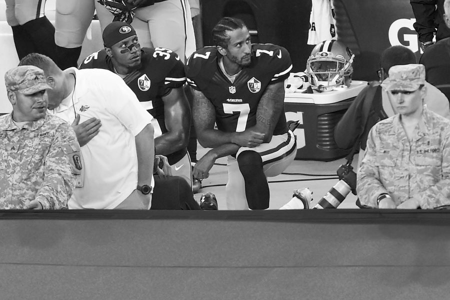 San Francisco 49ers quarterback Colin Kaepernick (7) and Eric Reid (35) kneel down during the playing of the national anthem before their NFL game on Monday, Sept. 12, 2016 at Levi's Stadium in Santa Clara, Calif. (Jose Carlos Fajardo/Bay Area News Group/TNS)