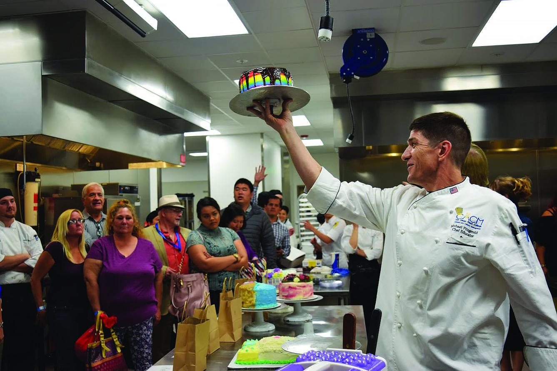 Professor Michael Fitzgerald    conducting the cake auction.