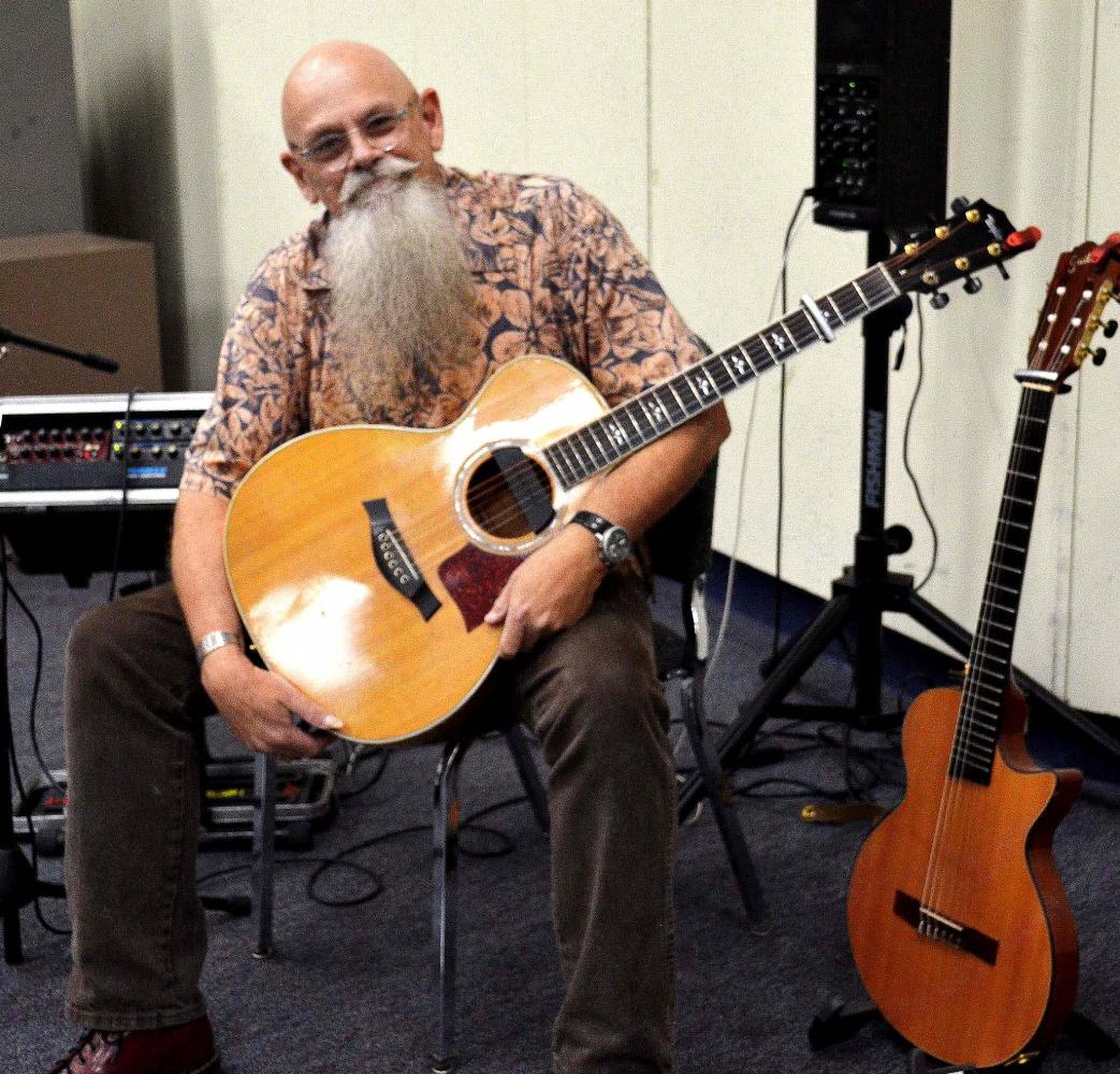 Jim Earp, a two-time top five finalist in the International Fingerstyle Guitar Championships.